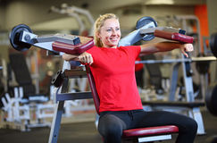 Cheerful young woman working out in gym Royalty Free Stock Photography