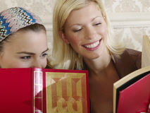 Cheerful Young Women With Books Stock Image
