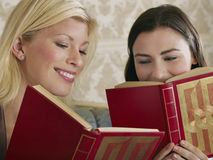 Cheerful Young Women With Books Stock Photo
