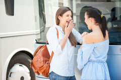 Cheerful young women are enjoying their travel Royalty Free Stock Image