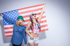 Cheerful young women are expressing their patriotism Stock Photos