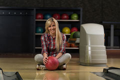 Cheerful Young Women Holding Bowling Ball Royalty Free Stock Image