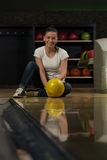 Cheerful Young Women Holding Bowling Ball Royalty Free Stock Photography