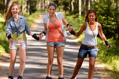 Cheerful young women on roller skates outdoor Royalty Free Stock Photo