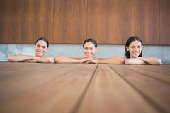 Cheerful young women in swimming pool Stock Image