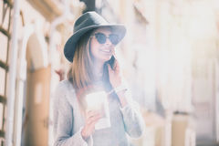 Cheerful young womna talking on cell phone Royalty Free Stock Photography