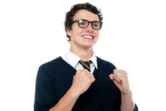 Cheerful youngster celebrating his success Royalty Free Stock Photo