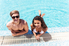 Cheerful youthful guy and lady resting while swimming outdoor Royalty Free Stock Photography