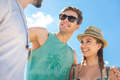 Cheerful youthful men and woman having summer rest outdoor Royalty Free Stock Photo