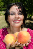 Cheerfull brunette picking fruits Royalty Free Stock Photo