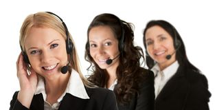 Cheerfull call center operators. Group of cheerfull call center operators. Isolated on white Royalty Free Stock Image