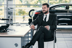 Cheerfull customer at dealership showroom.  Stock Image