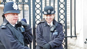 Cheerfull police officers at buckingham palace stock footage