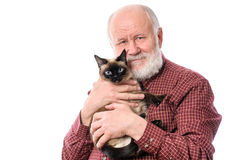 Cheerfull senior man with cat isolated on white. Headshot of cheerful and calm handsome bald and bearded senior man with siamese cat, isolated on white Stock Image