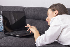 Cheerfull smiling woman working with laptop Royalty Free Stock Photography