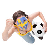 Cheerfully female swedish soccer fan with a football Royalty Free Stock Photography
