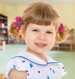 Cheerfully smiling little girl Royalty Free Stock Photos