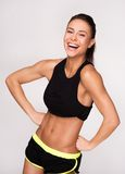 Cheerfully smiling mixed race sporty woman Stock Photography