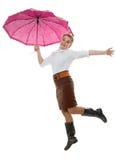 Cheerfully under a umbrella Stock Photo