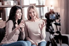 Delighted female bloggers recording a video stock images