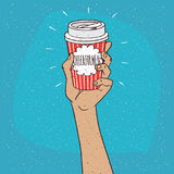 Cheerfulness on paper cup of coffee. Extended upwards hand holding shiny trendy paper cup of coffee, on which the inscription Cheerfulness. Blue background Stock Images