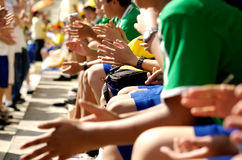 Cheering. Students Cheering schoold sport event. Very shallow depth of field stock image