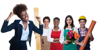 Cheering african american businesswoman with group of other apprentices Stock Photography