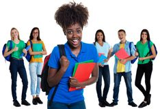 Cheering african american female student with group of students stock photos