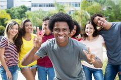 Cheering african american guy with group of international friend royalty free stock photo