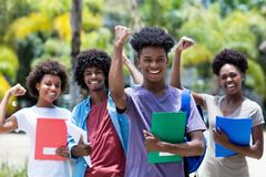 Cheering african male student with group of african american students stock image