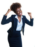 Cheering american business woman Stock Photo