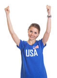 Cheering american woman. Cheering female sports fan from USA laughing at camera on an isolated white background Royalty Free Stock Photography