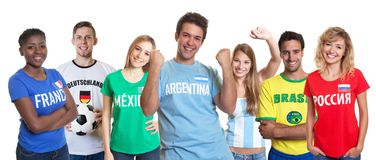 Cheering argentinian soccer fan with ball and cheering group of stock images