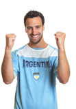 Cheering argentinian soccer fan Stock Photography