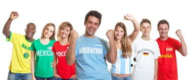 Cheering argentinian soccer supporter with fans from other count stock images