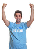 Cheering argentinian sports fan Stock Images