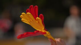 Cheering athletes with applause from plastic palms.