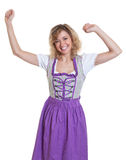 Cheering bavarian woman with curly blond hair Stock Images