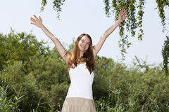 Cheering beautiful young woman Royalty Free Stock Photos