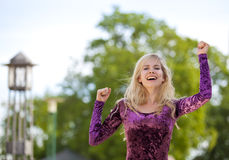 Cheering blond fashion model Royalty Free Stock Photography