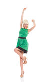Cheering blonde girl in green dress Royalty Free Stock Images