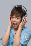 Cheering boy with headphones Stock Photos