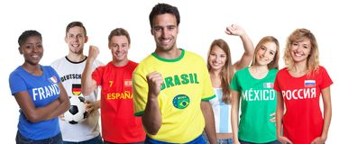 Cheering brazilian soccer supporter with fans from other countries stock photos