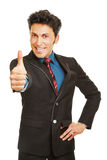 Cheering business man holding thumbs up Stock Photography
