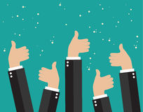 Cheering business people holding many thumbs Stock Photo