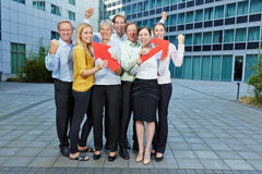 Cheering business people team with arrows Royalty Free Stock Image