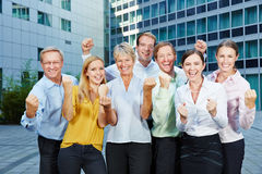 Cheering business people team clenching fists Stock Images