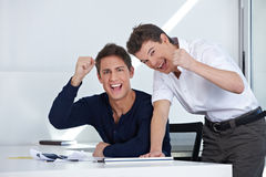 Cheering business people in their Royalty Free Stock Photo