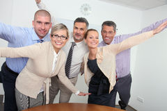 Cheering business team. Cheering business people in the office Stock Photos