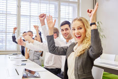 Cheering business team clentching their fists Royalty Free Stock Photo